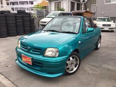 沖縄の中古車 日産 マーチ 車両価格 59万円 リ済込 平成9年 10.0万K グリーンM