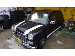 沖縄の中古車 ダイハツ ミラジーノ 車両価格 49万円 リ済込 平成14年 7.2万K パープルM
