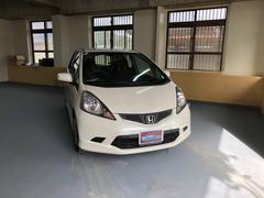 沖縄の中古車 ホンダ フィット 車両価格 45万円 リ済込 平成19年 6.7万K プレミアムホワイトパール