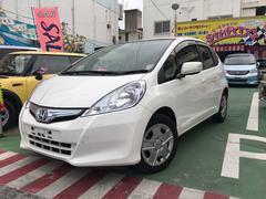 沖縄の中古車 ホンダ フィットハイブリッド 車両価格 61万円 リ済別 平成24年 8.5万K ホワイト