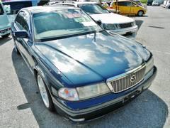 沖縄の中古車 マツダ センティア 車両価格 49万円 リ済込 平成10年 7.4万K ブルー