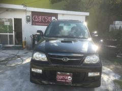 沖縄の中古車 ダイハツ テリオスキッド 車両価格 33万円 リ済込 平成21年 13.8万K ブラックM