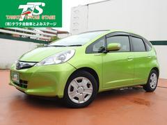 沖縄の中古車 ホンダ フィットハイブリッド 車両価格 66万円 リ済込 平成24年 7.5万K グリーンM