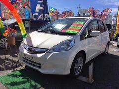 沖縄の中古車 ホンダ フィットハイブリッド 車両価格 66万円 リ済込 平成24年 6.3万K パールホワイト