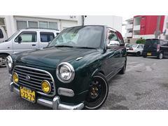 沖縄の中古車 ダイハツ ミラジーノ 車両価格 29万円 リ済込 平成13年 13.9万K グリーン