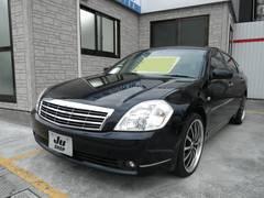 沖縄の中古車 日産 ティアナ 車両価格 26万円 リ済込 平成17年 14.2万K サファイアブラックP