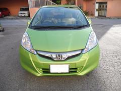 沖縄の中古車 ホンダ フィットハイブリッド 車両価格 62万円 リ済込 平成22年 13.2万K Lグリーン