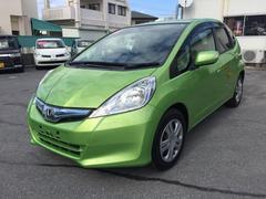 沖縄の中古車 ホンダ フィットハイブリッド 車両価格 53万円 リ済込 平成23年 8.8万K LグリーンM