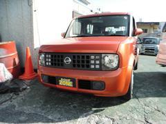 沖縄の中古車 日産 キューブ 車両価格 19万円 リ済込 平成17年 11.2万K オレンジM