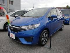 沖縄の中古車 ホンダ フィットハイブリッド 車両価格 148.8万円 リ済込 平成28年 0.9万K ブルーM
