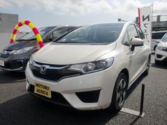 沖縄の中古車 ホンダ フィットハイブリッド 車両価格 151.8万円 リ済込 平成28年 0.9万K パールホワイト