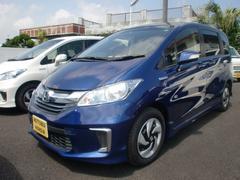 沖縄の中古車 ホンダ フリードハイブリッド 車両価格 192.8万円 リ済込 平成28年 0.9万K コバルトブルーパール
