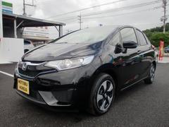 沖縄の中古車 ホンダ フィットハイブリッド 車両価格 149.8万円 リ済込 平成28年 0.9万K クリスタルブラックパール