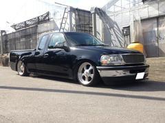 沖縄の中古車 フォード フォード F−150 車両価格 110万円 リ済込 1999年 7.2万K ブラック