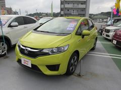 沖縄の中古車 ホンダ フィットハイブリッド 車両価格 149.8万円 リ済別 平成28年 0.9万K アトラクトイエロー