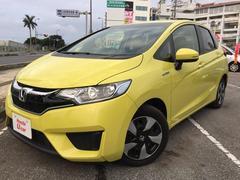 沖縄の中古車 ホンダ フィットハイブリッド 車両価格 158.8万円 リ済別 平成28年 0.8万K イエローパール