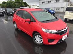 沖縄の中古車 ホンダ フィット 車両価格 133.8万円 リ済別 平成28年 1.1万K レッド