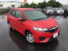 沖縄の中古車 ホンダ フィット 車両価格 139.8万円 リ済別 平成27年 1.1万K レッド