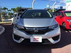 沖縄の中古車 ホンダ フィットハイブリッド 車両価格 149.8万円 リ済別 平成28年 0.9万K シルバーメタリック