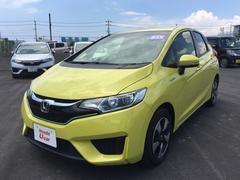 沖縄の中古車 ホンダ フィットハイブリッド 車両価格 149.8万円 リ済別 平成28年 0.9万K イエローパール
