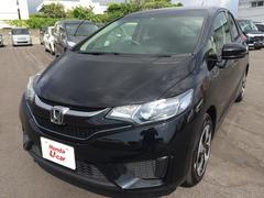 沖縄の中古車 ホンダ フィットハイブリッド 車両価格 164.8万円 リ済別 平成28年 1.2万K ブラックパール