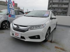 沖縄の中古車 ホンダ グレイス 車両価格 205.8万円 リ済別 平成28年 0.7万K ホワイトオーキッドパール