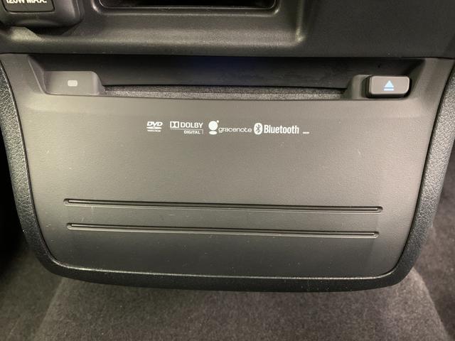 アブソルート 4WD フルセグ HDDナビ DVD再生 ミュージックプレイヤー接続可 バックカメラ ETC HIDヘッドライト 乗車定員7人 3列シート(30枚目)