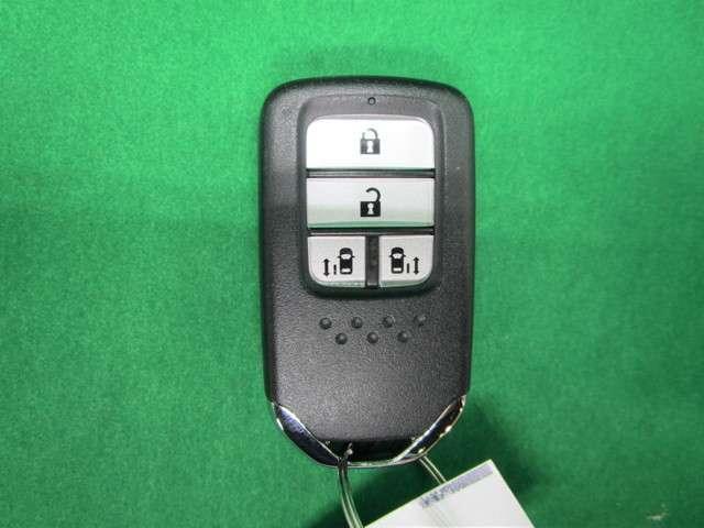 スパーダ ホンダセンシング 純正9インチSDナビフルセグTV DVD再生可能 ブルートゥース 純正天吊モニター ワンオーナー バックカメラ ETC LEDオートライト スマートキー 両側電動スライドドア ホンダセンシング(11枚目)
