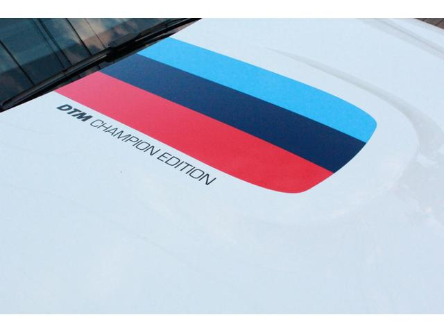 DTMチャンピオンエディション 国内25台限定・ディーラー車・左H・MDCT・ドライブロジック・カーボンブレーキ・CFPRルーフ・Mバケットシート・Mストライプ・Mステアリング・ロールゲージ・純正チタンマフラー・20インチAW(8枚目)
