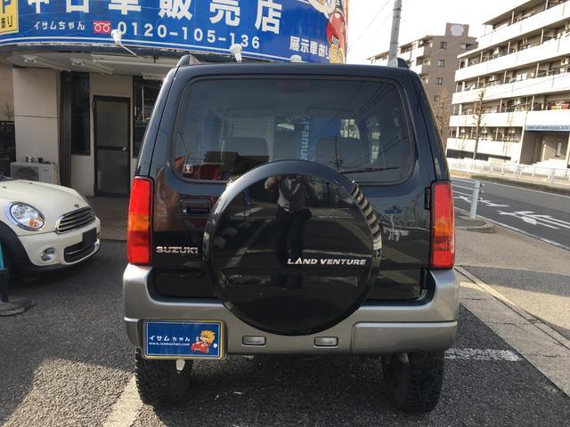 ランドベンチャー 禁煙車 4WD オフロードタイヤ ターボ ETC ナビ DVD シートヒーター  ハーフレザーシート 純正16インチAW(8枚目)