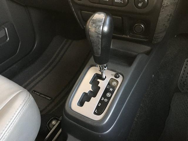 ランドベンチャー 禁煙車 4WD オフロードタイヤ ターボ ETC ナビ DVD シートヒーター  ハーフレザーシート 純正16インチAW(27枚目)