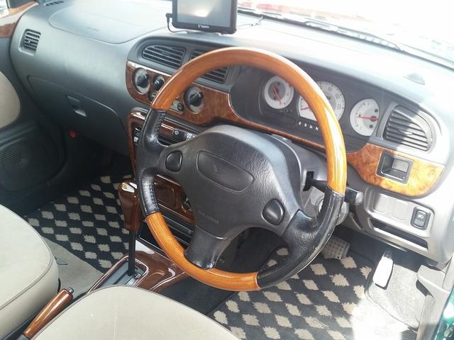 ダイハツ ミラジーノ ジーノ限定車 DCNグリル 一本出しマフラー ウッド調パーツ