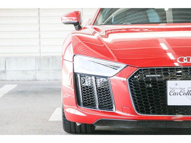 V10クーペ 5.2FSIクワトロ 正規ディーラー車 各所グロスブラック塗分 アクラポビッチマフラー KW車高調 外装スペシャルオーダーカラー ダイヤモンドキルティングレッドステッチ カーボンサイドブレード デコラティブカーボンパネル(11枚目)