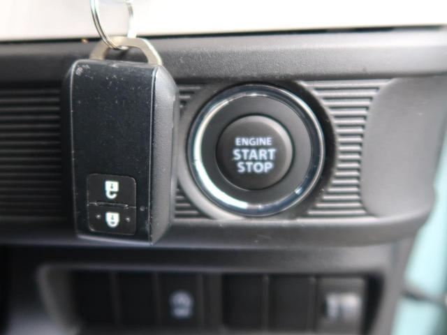 ハイブリッドG スマートキー アイドリングストップ オートエアコン オートライト 横滑り防止装置 シートベルトアジャスター シートアンダーボックス ドアバイザー 電動格納ミラー バニティミラー 革巻きステアリング(6枚目)