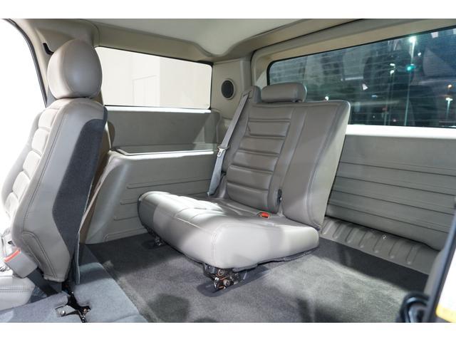 グリルガード LEDヘッド EliteMax22AW マッドタイヤ Bassani2本出しマフラー サンルーフ バネサス サイドステップ バックカメラ イエローフォグ ACパネル移設 3列シート(35枚目)