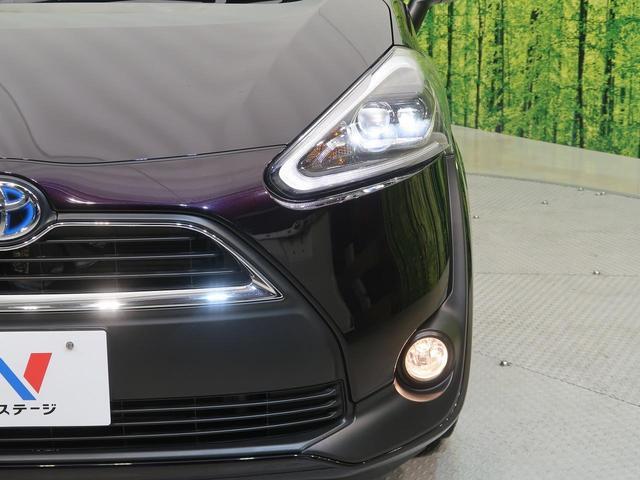 ハイブリッドG クエロ セーフティセンス 両側電動スライドドア SDナビ 地デジ バックカメラ ハーフレザーシート ETC LEDヘッド スマートキー オートエアコン オートライト 電動格納ミラー ABS ESC 記録簿(21枚目)