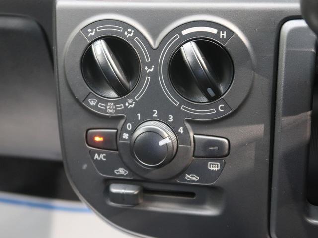 L キーレス 純正CDオーディオ 運転席シートヒーター ハロゲンヘッドライト マニュアルエアコン 純正ホイールキャップ アイドリングストップ ヘッドライトレベライザー 横滑り防止機能 禁煙車(4枚目)