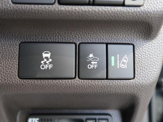 G・ホンダセンシング 衝突軽減装置 禁煙車 アダプティブクルーズコントロール 両側電動スライド ステアリングスイッチ シートリフター オートエアコン スマートキー 横滑り防止装置 プッシュスタート(32枚目)