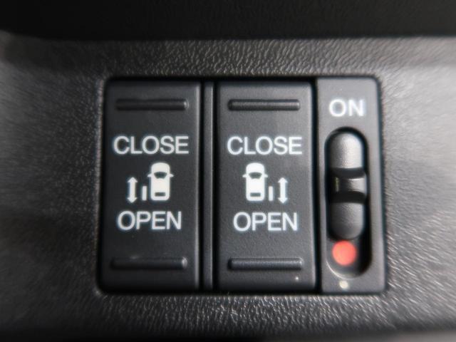 スパーダ ホンダセンシング 純正9インチナビ 後席モニタ 両側電動スライドドア 衝突被害軽減装置 全周囲カメラ ETC アダプティブクルコン LEDヘッドライト アイドリングストップ 純正16AW スマートキー(6枚目)