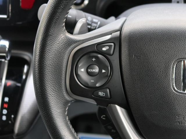 スパーダ ホンダセンシング 純正9インチナビ 後席モニタ 両側電動スライドドア 衝突被害軽減装置 全周囲カメラ ETC アダプティブクルコン LEDヘッドライト アイドリングストップ 純正16AW スマートキー(23枚目)