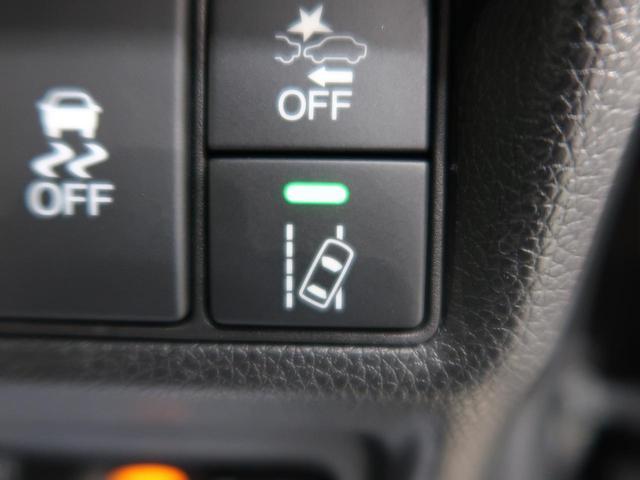 スパーダ ホンダセンシング 純正9インチナビ 後席モニタ 両側電動スライドドア 衝突被害軽減装置 全周囲カメラ ETC アダプティブクルコン LEDヘッドライト アイドリングストップ 純正16AW スマートキー(38枚目)