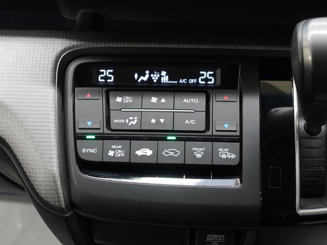 スパーダ ホンダセンシング 純正9インチナビ 後席モニタ 両側電動スライドドア 衝突被害軽減装置 全周囲カメラ ETC アダプティブクルコン LEDヘッドライト アイドリングストップ 純正16AW スマートキー(42枚目)