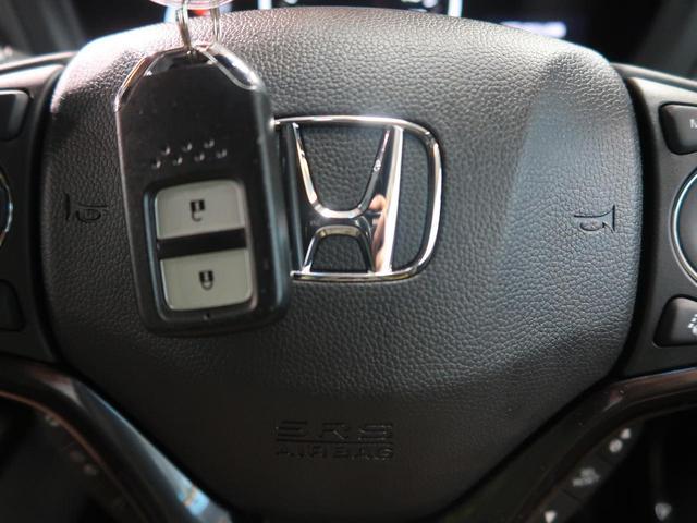 ハイブリッドRS・ホンダセンシング 現行 レーダークルーズ 登録済未使用車 ETC バックカメラ 衝突被害軽減装置 専用スポーツシート レーダークルーズ オートエアコン LEDヘッドライト(39枚目)