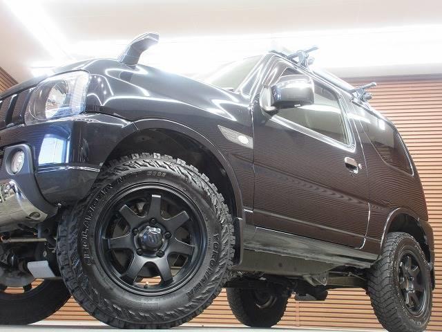 ランドベンチャー 4WD 社外マフラー 社外AW 5速MT ターボ オーディオ 背面タイヤ レザーシート シートヒーター ステアリングリモコン TERZOルーフキャリア ツィーター フォグランプ(19枚目)