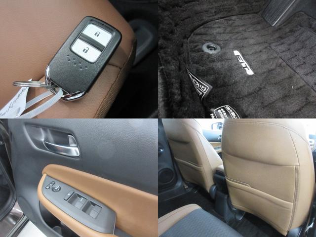 e:HEVリュクス 4WD ホンダセンシング ホンダコネクト フルLEDヘッドライト シートヒーター ステアリングヒーター アームレスト付センターコンソールボックス Qi規格ワイヤレス充電器 本革ブラウン内装(10枚目)