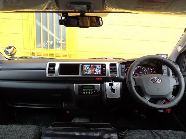 SロングワイドDX 4WD キャンピング 走行6,500km シンク ベッド 電子レンジ 冷蔵庫 リヤガソリンヒーター カーテン テレビ ボディーコーティング 下廻防錆 車庫保管 左パワスラ モデューロエアロ ワンオーナ(7枚目)