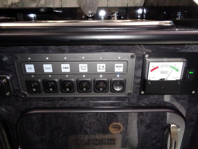 SロングワイドDX 4WD キャンピング 走行6,500km シンク ベッド 電子レンジ 冷蔵庫 リヤガソリンヒーター カーテン テレビ ボディーコーティング 下廻防錆 車庫保管 左パワスラ モデューロエアロ ワンオーナ(14枚目)