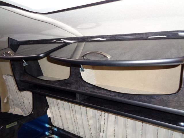 SロングワイドDX 4WD キャンピング 走行6,500km シンク ベッド 電子レンジ 冷蔵庫 リヤガソリンヒーター カーテン テレビ ボディーコーティング 下廻防錆 車庫保管 左パワスラ モデューロエアロ ワンオーナ(19枚目)