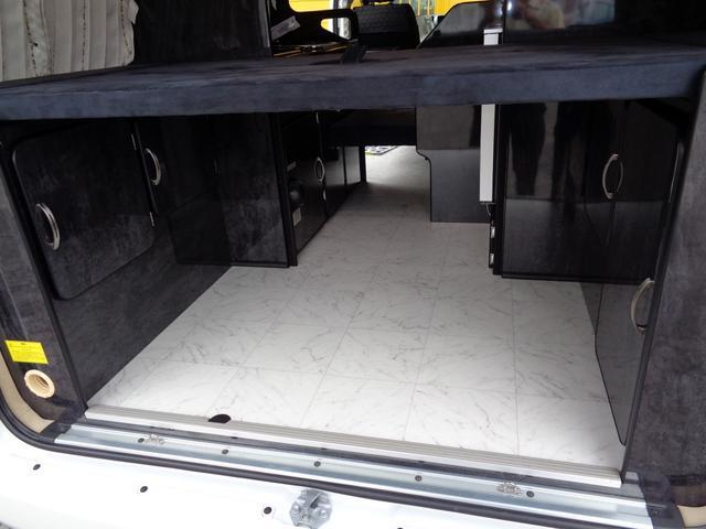 SロングワイドDX 4WD キャンピング 走行6,500km シンク ベッド 電子レンジ 冷蔵庫 リヤガソリンヒーター カーテン テレビ ボディーコーティング 下廻防錆 車庫保管 左パワスラ モデューロエアロ ワンオーナ(28枚目)