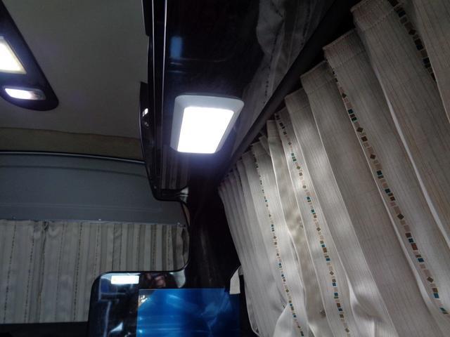 SロングワイドDX 4WD キャンピング 走行6,500km シンク ベッド 電子レンジ 冷蔵庫 リヤガソリンヒーター カーテン テレビ ボディーコーティング 下廻防錆 車庫保管 左パワスラ モデューロエアロ ワンオーナ(48枚目)